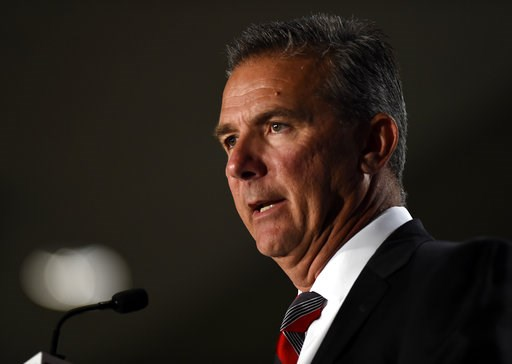 (AP Photo/Annie Rice, File). File-This July 24, 2018, file photo shows Ohio State head coach Urban Meyer speaking at the Big Ten Conference NCAA college football Media Days in Chicago. The Big Ten East has been called the toughest division in college f...