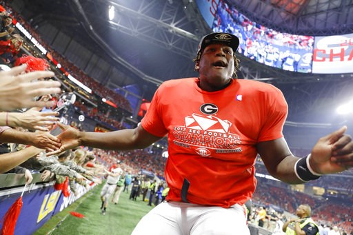 (AP Photo/David Goldman, File). FILE - In this Dec. 2, 2017, file photo, Georgia offensive lineman Isaiah Wilson celebrates a Georgia win over Auburn in the Southeastern Conference championship NCAA college football game in Atlanta. Wilson has been wor...