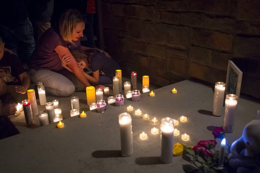 (Timothy Hurst/The Coloradoan via AP). Jeanna Dietz hugs her daughter Eva, 7, while looking onto memorial on the front porch while others gather for a candle-lit vigil for Shanann Watts and her two daughters, Bella, 4, and Celeste, 3, in front of the W...