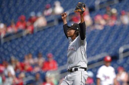 (AP Photo/Nick Wass). Miami Marlins starting pitcher Jose Urena begins to celebrate as he threw a complete baseball game against the Washington Nationals, Sunday, Aug. 19, 2018, in Washington.