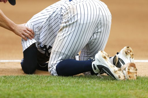 (AP Photo/Noah K. Murray). New York Yankees' Didi Gregorius goes down after a collision with Toronto Blue Jays first baseman Kendrys Morales in the first inning of a baseball game against the Toronto Blue Jays in New York, Sunday, Aug. 19, 2018.