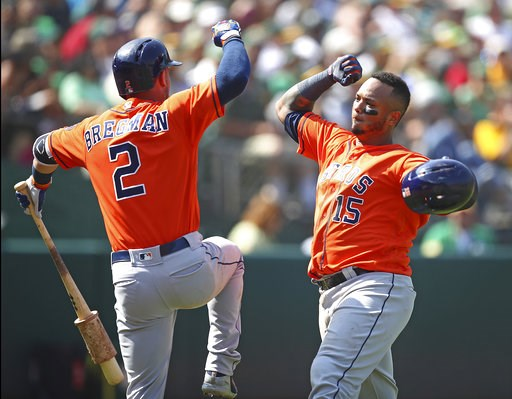 (AP Photo/Ben Margot). Houston Astros' Martin Maldonado, right, celebrates with Alex Bregman (2) after hitting a home run off Oakland Athletics' Emilio Pagan in the seventh inning of a baseball game Sunday, Aug. 19, 2018, in Oakland, Calif.
