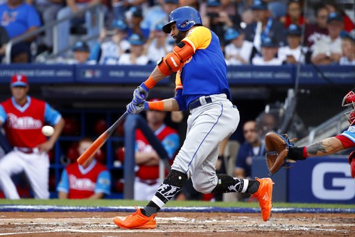 (AP Photo/Gene J. Puskar). New York Mets' Jose Bautista drives in a run with a single off Philadelphia Phillies starting pitcher Adam Morgan in the second inning of the Little League Classic baseball game at Bowman Field in Williamsport, Pa., Sunday, A...