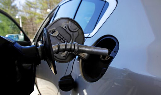 (AP Photo/Charles Krupa, File). FILE- In this April 23, 2018, file photo a car is filled with gasoline at a station in Windham, N.H. Conserving oil is no longer an economic imperative for the U.S., the Trump administration declares in a major new polic...