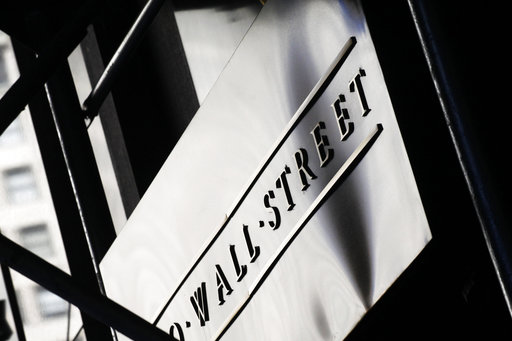 (AP Photo/Mark Lennihan, File). FILE - This July 15, 2013, file photo, shows a sign for Wall Street outside the New York Stock Exchange. The U.S. stock market opens at 9:30 a.m. EDT on Monday, Aug. 20, 2018.
