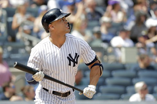 (AP Photo/Julio Cortez). New York Yankees' Giancarlo Stanton watches his solo home run off Toronto Blue Jays starting pitcher Sean Reid-Foley during the fourth inning of a baseball game, Saturday, Aug. 18, 2018, in New York.