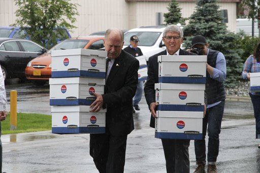 (AP Photo/Mark Thiessen). Alaska Gov. Bill Walker, left, and Lt. Gov. Byron Mallott carry boxes into the Division of Elections office in Anchorage, Alaska, Monday, Aug. 20, 2018, after the two men gathered signatures to get their ticket on the November...