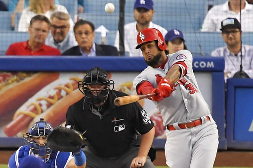 (AP Photo/Mark J. Terrill). St. Louis Cardinals' Jose Martinez, right, hits a solo home run as Los Angeles Dodgers catcher Austin Barnes, left, watches along with home plate umpire Sam Holbrook during the first inning of a baseball game Monday, Aug. 20...