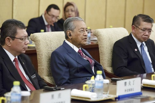 (Roman Pilipey/Pool Photo via AP). Malaysian Prime Minister Mahathir Mohamad, center, speaks to Chinese President Xi Jinping (not pictured) during their meeting at Diaoyutai State Guesthouse in Beijing, Monday, Aug. 20, 2018.