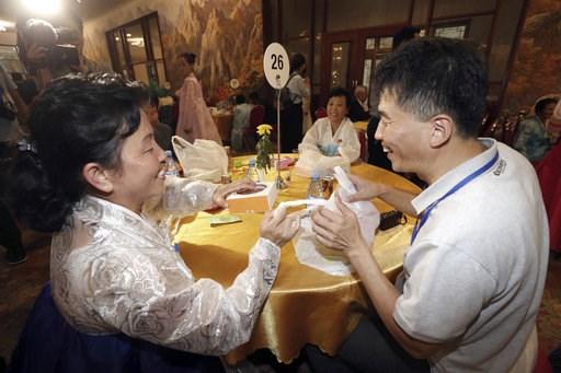(Korea Pool Photo via AP). North Korean Ra Sun Ok, 58, left, talks with her South Korean relative Na Sung-phil, 51, during a separated family reunion meeting at the Diamond Mountain resort in North Korea, Tuesday, Aug. 21, 2018. Dozens of elderly South...