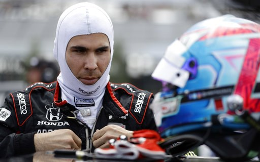 (AP Photo/Matt Slocum). Robert Wickens prepares to qualify for Sunday's IndyCar series auto race, Saturday, Aug. 18, 2018, in Long Pond, Pa.
