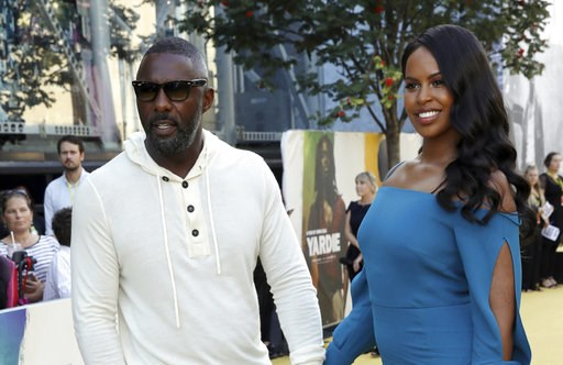 (Photo by Grant Pollard/Invision/AP). Director Idris Elba, left, and partner Sabrina Dhowre pose for photographers on arrival at the premiere of the film 'Yardie', in London, Tuesday, Aug. 21, 2018.