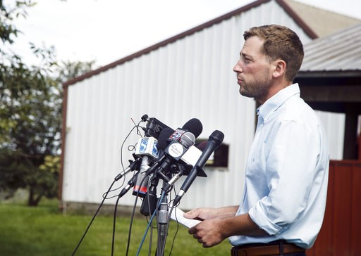 (Brian Powers /The Des Moines Register via AP, File). FILE - In this Aug. 22, 2018 file photo, Dane Lang, co-owner of Yarrabee Farms, speaks to the media on the family farm in Brooklyn, Iowa. Cristhian Bahena Rivera, a former employee at the farm who w...