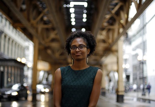 (AP Photo/Kiichiro Sato). In this Sept. 7, 2018 photo, Adrienne Alexander poses for a photo under Chicago's el train track in downtown. Alexander is among countless members of the Catholic laity in the U.S. who are raising their voices in prayer and pr...