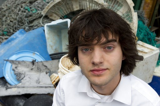 (AP Photo/Peter Dejong, File). FILE - In this May 11, 2017, file photo, Dutch innovator Boyan Slat poses for a portrait next to a pile of plastic garbage prior to a press conference in Utrecht, Netherlands. Engineers will deploy a trash collection devi...