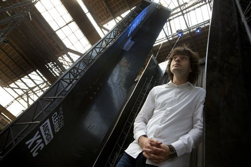(AP Photo/Peter Dejong, File). FILE - In this May 11, 2017, file photo, Dutch innovator Boyan Slat poses for a portrait next to the anchors of his plastic collecting system, suspended from the roof of a building in Utrecht, Netherlands. Engineers will ...
