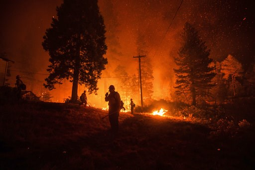 (AP Photo/Noah Berger). Firefighters monitor a backfire while battling the Delta Fire in the Shasta-Trinity National Forest, Calif., on Thursday, Sept. 6, 2018. The wildfire that erupted Wednesday has now burned more than 34 square miles (89 square kil...