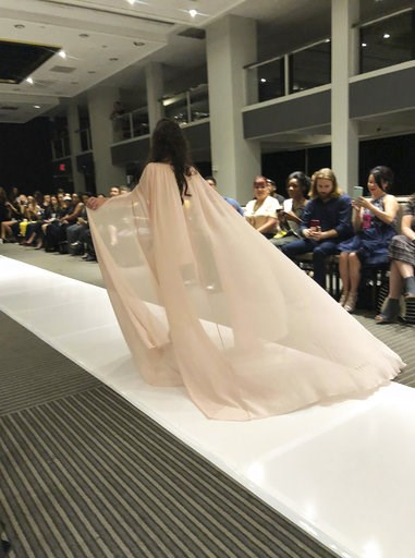 (AP Photo/Leanne Italie). Model Marian Avila wears an outfit from the Talisha White 2019 spring collection on the runway during Fashion Week, Saturday, Sept. 8, 2018, in New York. Avila, a 21-year-old Spanish model with Down syndrome, fulfilled her dre...