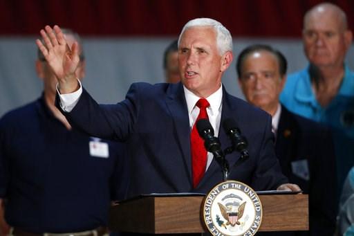 (Steve Marcus/Las Vegas Sun via AP). Vice President Mike Pence speaks to airmen during a visit to Nellis Air Force Base in Las Vegas Friday, Sept. 7, 2018.