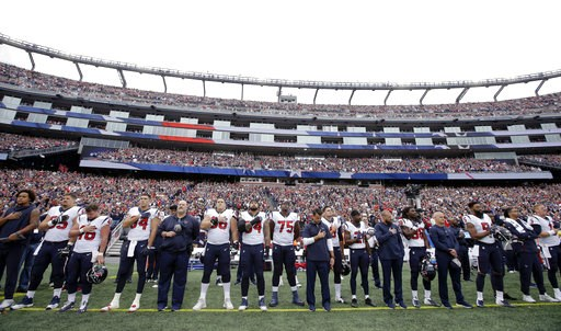 (AP Photo/Steven Senne). Houston Texans players stand during the national anthem before an NFL football game against the New England Patriots, Sunday, Sept. 9, 2018, in Foxborough, Mass.