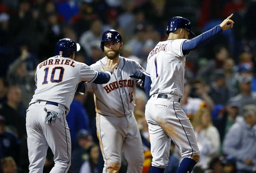 (AP Photo/Michael Dwyer). Houston Astros' Carlos Correa (1) and Yuli Gurriel (10) celebrate after scoring on a two-run double by Tyler White during the sixth inning of a baseball game against the Boston Red Sox in Boston, Sunday, Sept. 9, 2018.