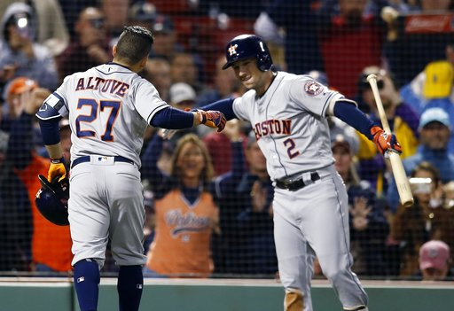 (AP Photo/Michael Dwyer). Houston Astros' Jose Altuve (27) celebrates his solo home run with Alex Bregman (2) during the sixth inning of a baseball game against the Boston Red Sox in Boston, Sunday, Sept. 9, 2018.