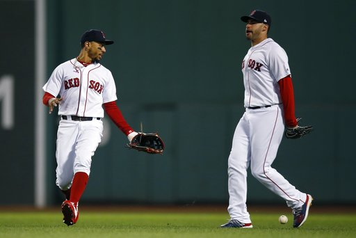 (AP Photo/Michael Dwyer). Boston Red Sox's Mookie Betts, left, and J.D. Martinez react after the double by Houston Astros' Alex Bregman dropped between them during the third inning of a baseball game in Boston, Sunday, Sept. 9, 2018.