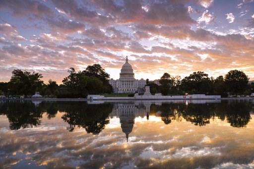 (AP Photo/J. Scott Applewhite, File). FILE - in this Oct. 10, 2017, file photo, the U.S. Capitol is seen at sunrise, in Washington. Control of Congress and the future of Donald Trump's presidency are on the line as the 2018 primary season winds to a cl...
