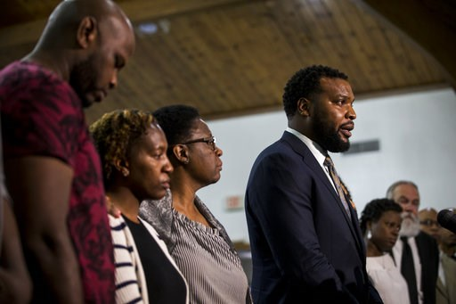 (Shaban Athuman/The Dallas Morning News via AP). Jean's family lawyer Lee Merritt gives talks to members of the press following a prayer vigil for Botham Shem Jean at the Dallas West Church of Christ on Saturday, Sept. 8, 2018 in Dallas. He was shot by...