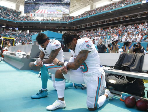 (AP Photo/Wilfredo Lee). Miami Dolphins wide receiver Kenny Stills (10) and Miami Dolphins wide receiver Albert Wilson (15) kneel during the national anthem before an NFL football game against the Tennessee Titans, Sunday, Sept. 9, 2018, in Miami Garde...