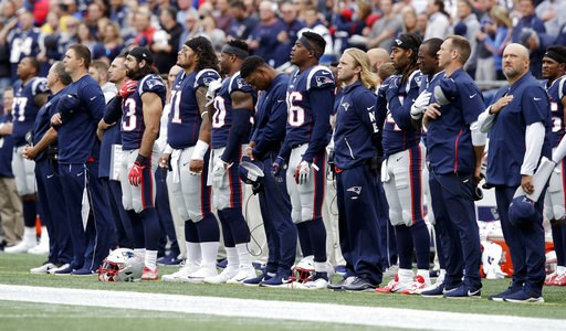 (AP Photo/Charles Krupa). New England Patriots players stand during the national anthem before an NFL football game against the Houston Texans, Sunday, Sept. 9, 2018, in Foxborough, Mass.