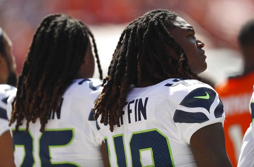 (AP Photo/David Zalubowski). Seattle Seahawks linebacker Shaquem Griffin, right, lines up alongside his brother, left, cornerback Shaquill Griffin,  during the playing of the national anthem before an NFL football game against the Denver Broncos, Sunda...