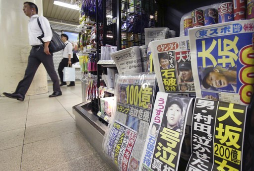 (AP Photo/Koji Sasahara). Sports and tabloid newspapers reporting Naomi Osaka's victory in the U.S. Open tennis finals are sold at a newsstand in Tokyo, Monday, Sept. 10, 2018. Osaka defeated Serena Williams of the U.S. 6-2, 6-4 on Saturday night to be...