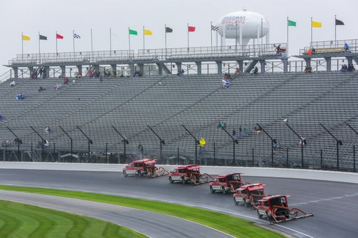 (AP Photo/R Brent Smith). Trucks try to dry the track during a rain delay before a NASCAR Brickyard 400 auto race at Indianapolis Motor Speedway in Indianapolis, Sunday, Sept. 9, 2018. The race was postponed until Monday, Sept. 10.