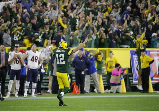 (AP Photo/Mike Roemer). Green Bay Packers' Aaron Rodgers reacts after throwing a 75-yard touchdown pass to Randall Cobb during the second half of an NFL football game against the Chicago Bears Sunday, Sept. 9, 2018, in Green Bay, Wis.