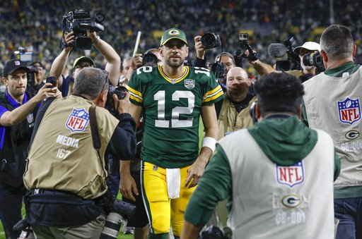 (AP Photo/Mike Roemer). Green Bay Packers' Aaron Rodgers walks off the field after an NFL football game against the Chicago Bears Sunday, Sept. 9, 2018, in Green Bay, Wis. The Packers won 24-23.