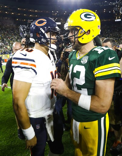 (AP Photo/Mike Roemer). Green Bay Packers' Aaron Rodgers talks to Chicago Bears' Mitchell Trubisky after an NFL football game Sunday, Sept. 9, 2018, in Green Bay, Wis. The Packers won 24-23.