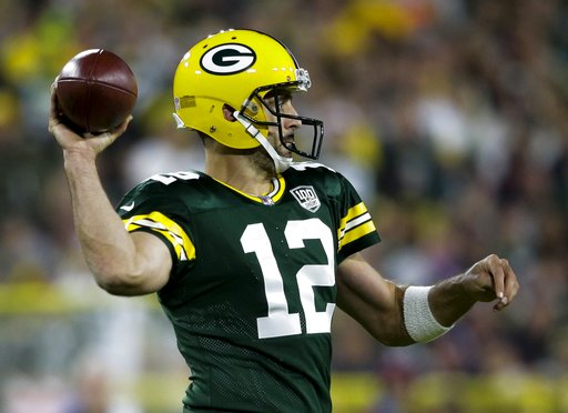 (AP Photo/Jeffrey Phelps). Green Bay Packers' Aaron Rodgers throws during the second half of an NFL football game -against the Chicago Bears Sunday, Sept. 9, 2018, in Green Bay, Wis.