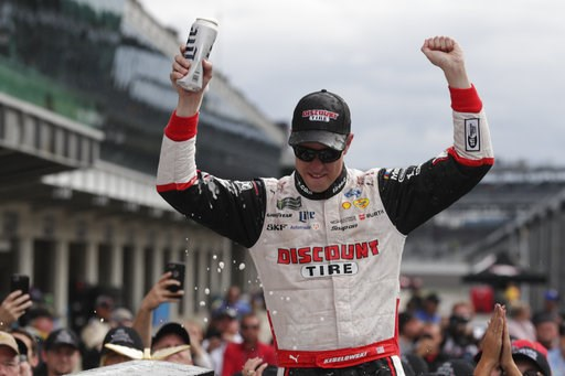 (AP Photo/Michael Conroy). NASCAR Cup Series driver Brad Keselowski (2) celebrates after winning the NASCAR Brickyard 400 auto race at Indianapolis Motor Speedway, in Indianapolis Monday, Sept. 10, 2018.