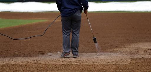 (AP Photo/Matt Slocum). A grounds crew member heats the infield of Citizens Bank Park before a baseball game between the Philadelphia Phillies and Washington Nationals, Monday, Sept. 10, 2018, in Philadelphia.