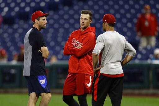 (AP Photo/Matt Slocum). Washington Nationals' Max Scherzer, left, Philadelphia Phillies' Rhys Hoskins, center, and manager Gabe Kapler talk before a baseball game, Monday, Sept. 10, 2018, in Philadelphia.