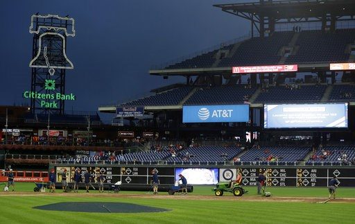 (AP Photo/Matt Slocum). Grounds crew members work on the infield of Citizens Bank Park before a baseball game between the Philadelphia Phillies and Washington Nationals, Monday, Sept. 10, 2018, in Philadelphia.