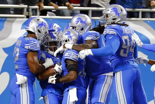 (AP Photo/Rick Osentoski). Detroit Lions cornerback Quandre Diggs (28) celebrates with teammates after an interception of a New York Jets quarterback Sam Darnold pass for a touchdown in the first quarter of an NFL football game in Detroit, Monday, Sept...