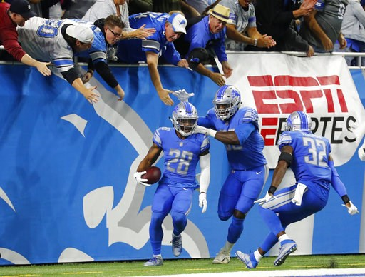(AP Photo/Rick Osentoski). Detroit Lions cornerback Quandre Diggs (28) celebrates his interception for a touchdown of a New York Jets quarterback Sam Darnold pass in the first quarter of an NFL football game in Detroit, Monday, Sept. 10, 2018.