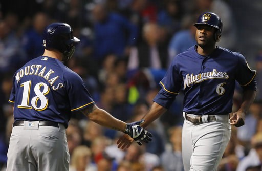 (AP Photo/Jim Young). Milwaukee Brewers' Lorenzo Cain, right, celebrates scoring a run against the Chicago Cubs with teammate Mike Moustakas during the first inning of a baseball game Monday, Sept. 10, 2018, in Chicago.