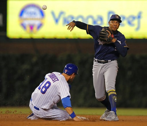 (AP Photo/Jim Young). Milwaukee Brewers' Jonathan Schoop, right, makes a throw to first base as Chicago Cubs' Ben Zobrist is out at second base during the fourth inning of a baseball game Monday, Sept. 10, 2018, in Chicago.