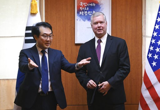(Jung Yeon-je/Pool Photo via AP). U.S. special envoy for North Korea Stephen Biegun, right, is ushered by South Korea's special representative for Korean Peninsula Peace and Security Affairs Lee Do-hoon, left, for their meeting at the Foreign Ministry ...