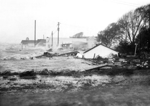 (AP Photo, File). FILE-In this Oct. 15, 1954 file photo, High tides, whipped in by Hurricane Hazel, shatter boats and buildings in Swansboro, N.C., as the storm lashes the Atlantic seaboard. The last time the midsection of the East Coast stared down a ...