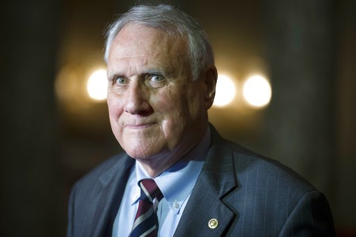 (AP Photo/Cliff Owen). FILE - In this Sept. 5, 2018, photo, Sen. Jon Kyl, R-Ariz., waits to be sworn-in by Vice President Mike Pence during his ceremonial swearing-in at the Old Senate Chamber on Capitol Hill, in Washington. After years of trying to de...