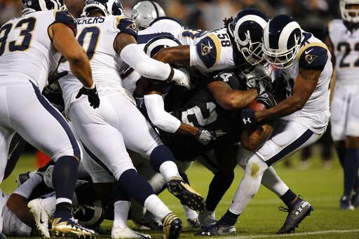 (AP Photo/John Hefti). Oakland Raiders running back Marshawn Lynch carries the ball into the end zone for a touchdown as Los Angeles Rams linebacker Cory Littleton (58) tries to stop him during the first half of an NFL football game against the Los Ang...